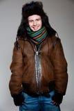 человек шлема пальто радостный стоковое фото rf