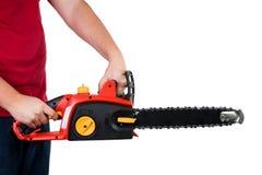 человек chainsaw изолированный удерживанием Стоковое фото RF