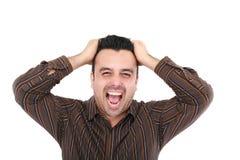 Человек screaming на камере Стоковое Фото