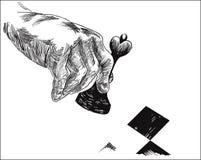 Человеческая рука держа часть ферзя шахмат Стоковые Изображения