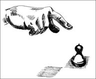 Человеческая рука указывая на часть пешки шахмат Стоковые Фото