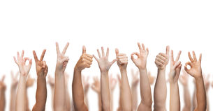 Человеческие руки показывая большие пальцы руки вверх, о'кеы и знаки мира Стоковые Фото