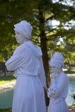 Человеческие скульптуры нося профиль тюрбанов Стоковые Фотографии RF
