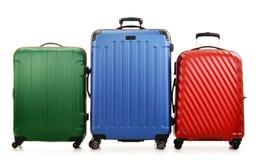 3 чемодана изолированного на белизне Стоковые Фото