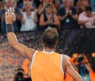 Чемпион Рафаэль Nadal грэнд слэм 17 времен Испании празднует победу после его спички полуфинала на открытом чемпионате Австралии  стоковые фотографии rf