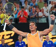 Чемпион Рафаэль Nadal грэнд слэм 17 времен Испании празднует победу после его спички полуфинала на открытом чемпионате Австралии  стоковое фото rf