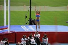 Чемпион e Isinbayeva после прыжка с шестом Стоковая Фотография