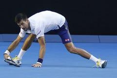 Чемпион Novak Djokovic грэнд слэм 11 времен Сербии в действии во время его спички круга 4 на открытом чемпионате Австралии по тен Стоковое Изображение