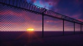 Через загородку тюрьмы металла с облаками колючей проволоки видимыми и нарушая заходом солнца Закрепляет петлей реалистическая 3D сток-видео