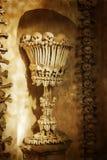 Черепа и косточки. Kutna Hora, чехия. текстурированная старая бумага Стоковое Изображение RF