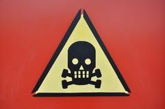 Череп знака опасности Стоковые Изображения RF