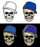 Череп нося голубую шляпу Стоковые Изображения