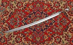 Черкесская шпага кавалерии в оболочке на ковре Стоковое Фото