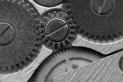 Черная белая металлическая предпосылка с cogwheels металла clockwork Стоковое фото RF
