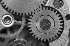 Черная белая предпосылка с cogwheels металла clockwork Концепция Стоковая Фотография RF