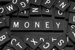 Черная буква кроет говорить черепицей слово & x22 по буквам; money& x22; Стоковое Изображение RF