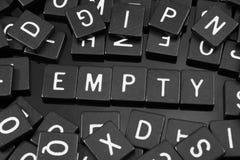 Черная буква кроет говорить черепицей слово & x22 по буквам; empty& x22; Стоковые Фотографии RF
