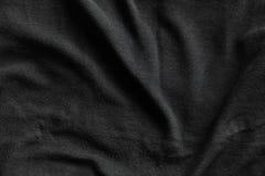 Черная ватка, текстура мягкой изолируя ткани стоковое фото