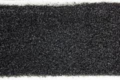Черная губка с белой текстурой холста стоковая фотография