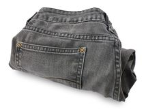 Черная джинсовая ткань Джин на белой предпосылке Стоковые Изображения RF