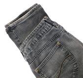 Черная джинсовая ткань Джин на белой предпосылке Стоковое Изображение RF