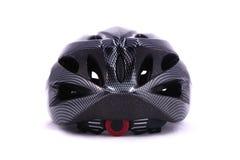 Черная задняя часть шлема велосипеда на белой предпосылке Стоковые Фото