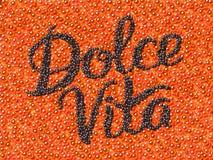 Черная икра помечая буквами Dolce Vita иллюстрация штока