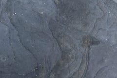 Черная каменная предпосылка картины природы стены мрамора камня крупного плана текстуры Стоковые Фото