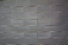 Черная кирпичная стена - новая Стоковая Фотография