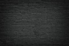 Черная кирпичная стена, предпосылка кирпичной кладки для дизайна Стоковое Фото