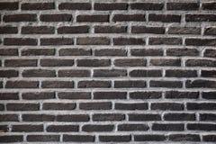 Черная кирпичная стена, предпосылка текстуры Стоковые Изображения