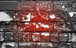 Черная кирпичная стена с красным пятном Стоковая Фотография RF