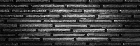 Черная кирпичная стена, темная предпосылка для дизайна Часть кирпичной стены покрашенной чернотой пусто Стоковое фото RF