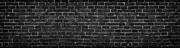 Черная кирпичная стена, широкая панорама как фон Стоковое фото RF