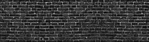 Черная кирпичная стена, широкая панорама как фон Стоковое Фото