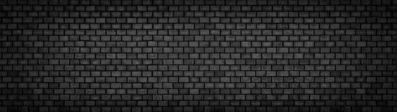 Черная кирпичная стена, широкая панорамная каменная поверхностная текстура Стоковая Фотография RF