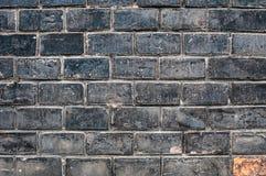 Черная кирпичная стена grunge Стоковое Изображение