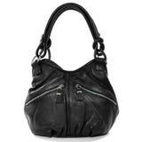 Черная кожаная женская сумка изолированная на белой предпосылке Styl утеса Стоковые Изображения