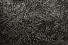Черная кожаная искусственная предпосылка текстуры Стоковое Изображение RF