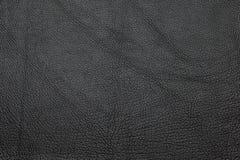 Черная кожаная grained предпосылка текстуры Стоковые Фотографии RF