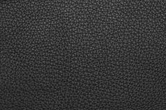 Черная кожаная grained предпосылка текстуры Стоковая Фотография