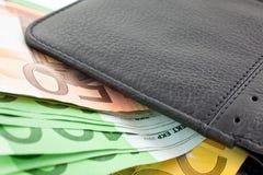 черная кожа евро замечает бумажник Стоковая Фотография
