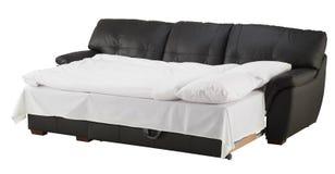 Черная коричневая кожаная угловая кровать кресла изолированная на белизне Стоковое Изображение