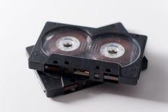Черная магнитофонная кассета 2 на белой предпосылке Стоковое Фото
