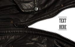 Черная молния куртки открытая на белизне изолировала предпосылку Стоковое фото RF