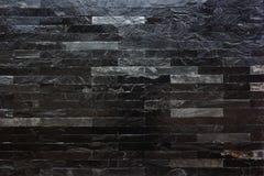 Черная мраморная каменная стена Стоковое Изображение