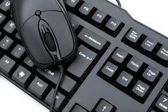 Черная мышь и черная клавиатура Стоковые Фотографии RF