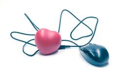 Черная мышь соединяясь к красному сердцу Стоковое Изображение