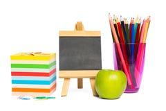 Черная доска с школьными принадлежностями Стоковые Фото