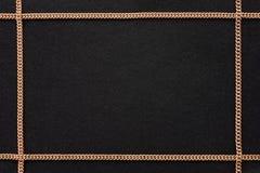 Черная предпосылка с золотой цепью Стоковые Изображения RF